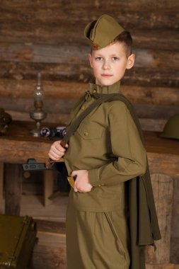 Russian boy in the old-fashioned Soviet military uniform