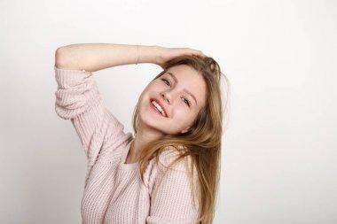 Close up portrait of pretty young schoolgirl with dark blonde ha