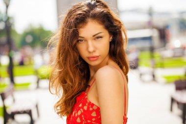 Beautiful brunette woman in sexy red dress