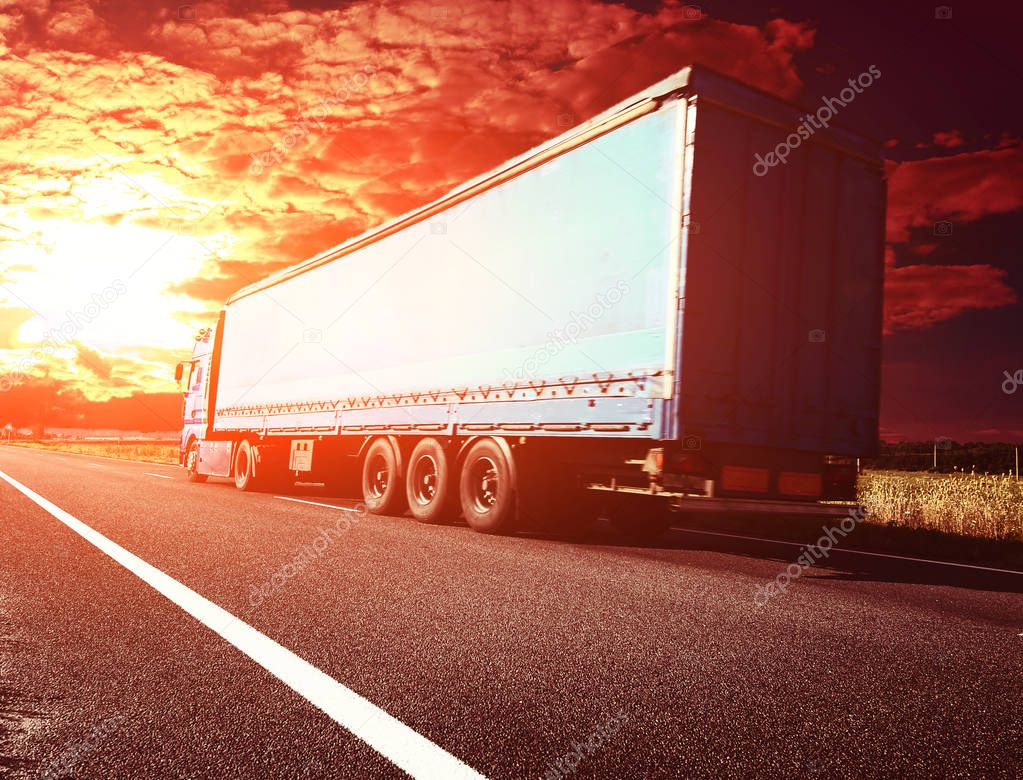 truck on road in sunset