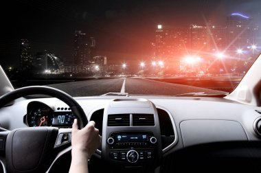 Drivers hands on steering wheel