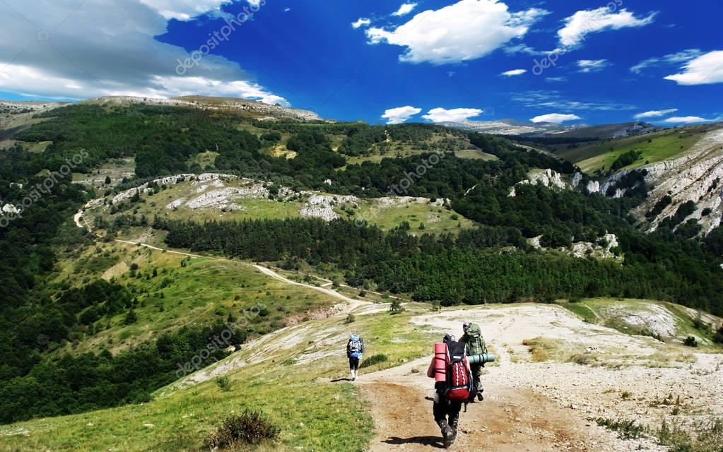 tourists are hiking in mountains