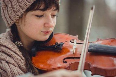 Teenage girl portrait with violin