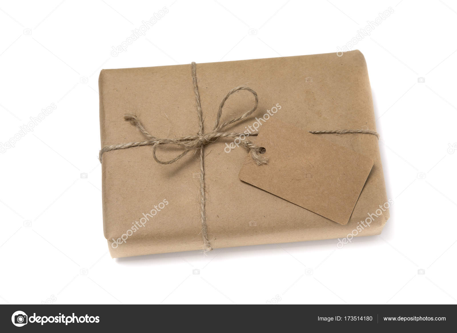 christmas or new year gift box wrapped in kraft paper with blank gift tag isolated on white background photo by vkph64