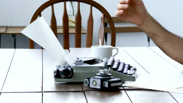 Writers hands on vintage typewriter in white room