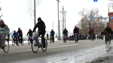 FEB 11, 2018, MOSCOW, RUSSIA: City of cyclists. Thousands of cyclists on a city street winter time. Traditional Bicycle parade in Moscow.