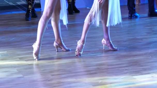 Dancers feet on a parquet floor