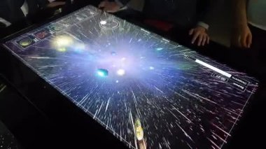 Kids plays on Interactive screen with game in Space hall