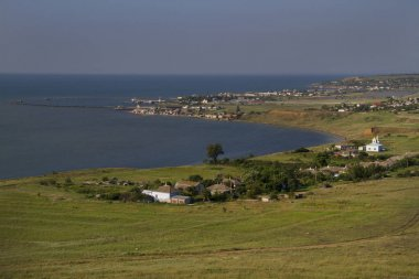 Views of village Podmayachny on the cape Fonar and sea