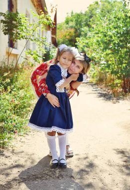 little schoolgirl with mother