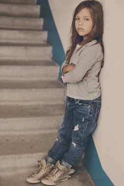 fashion little girl standing near on the stairs
