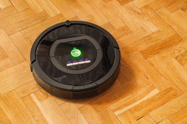 Robotic vacuum cleaner on parquet