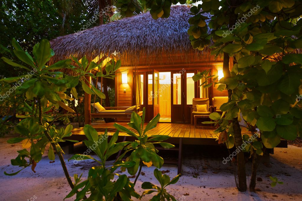 Beach bungalow at sunset - Maldives