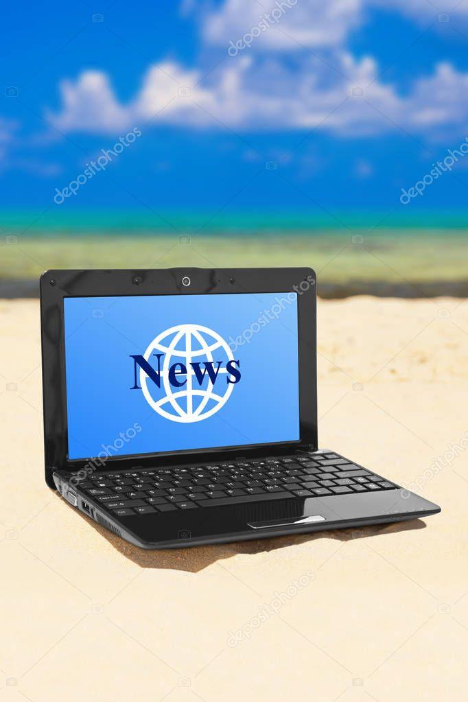 Notebook News on beach