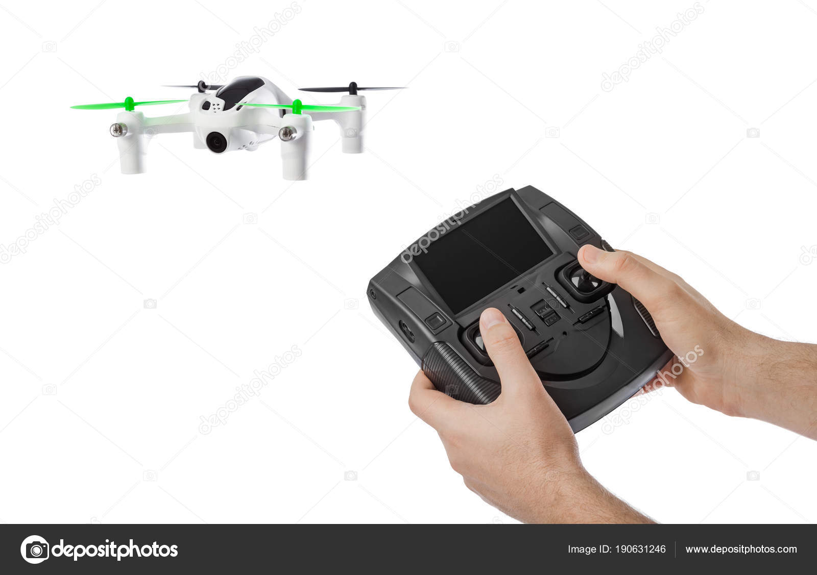 Drone and radio remote control in hands — Stock Photo
