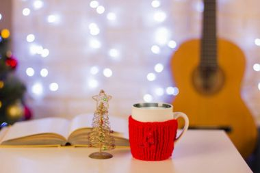 Christmas background with guitar.Still life in the home interior