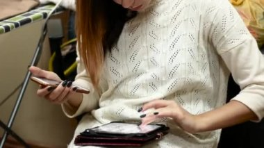 Close-up of businesswoman working on tablet