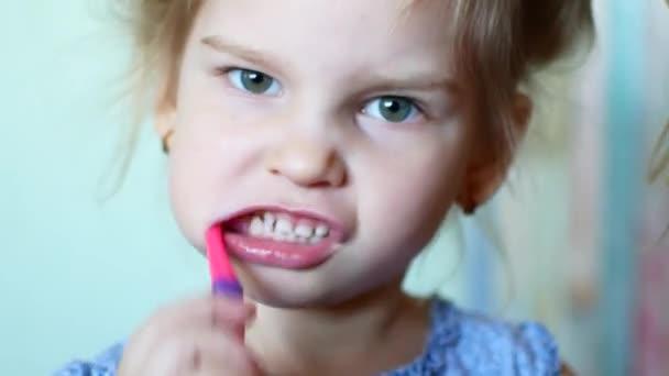 Little girl diligently brushing his teeth