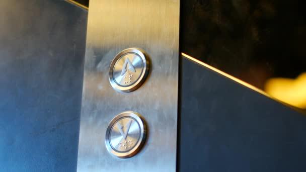 The child presses the elevator button.
