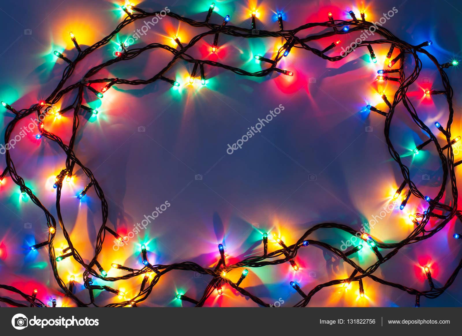 christmas lights frame on dark blue background photo by alexan66
