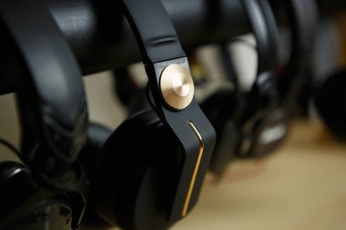 Collection of big professional stereo headphones on sale in dj shop.Buy hifi audio monitors for sound recording studio.