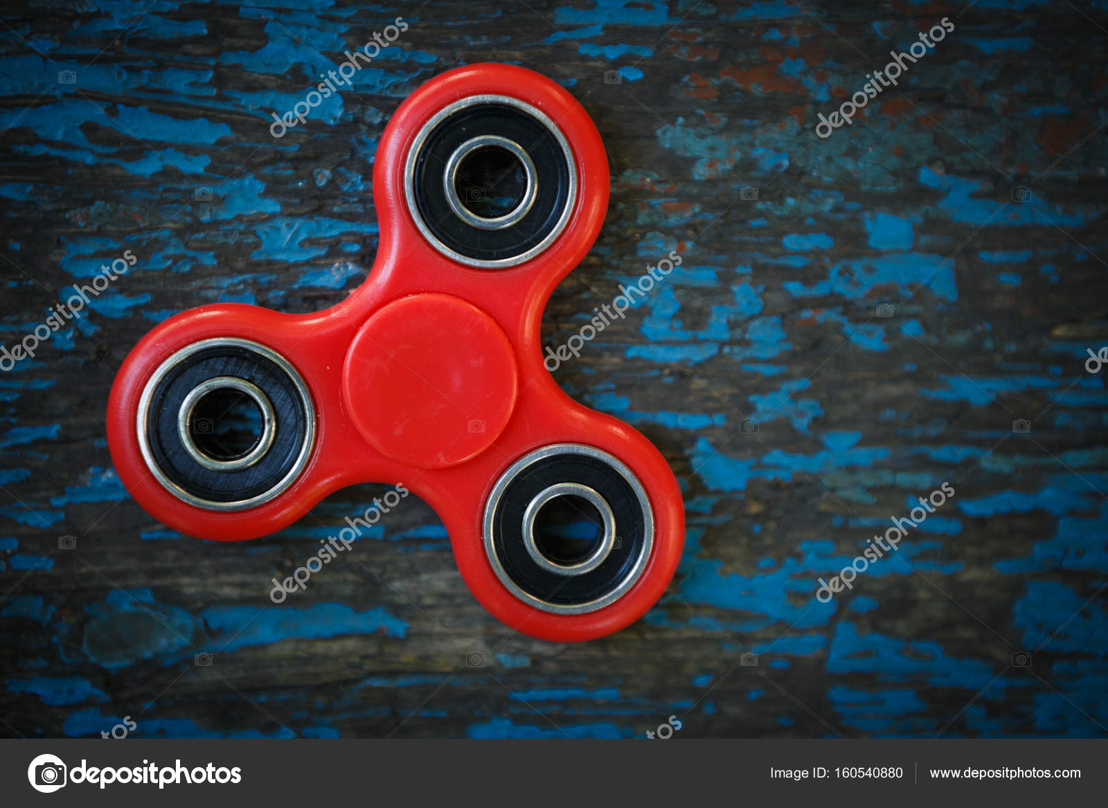 Red fidget spinner toy Spinning device with bearings — Stock