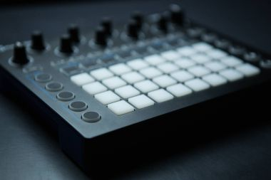 Drum machine midi controller for disc jockey,sound producer & composer.Produce music tracks with modern beat machine.Digital production center for sound recording studio