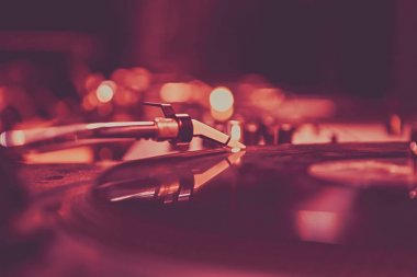 Vinyl records player in night club.Dj turntable device on stage