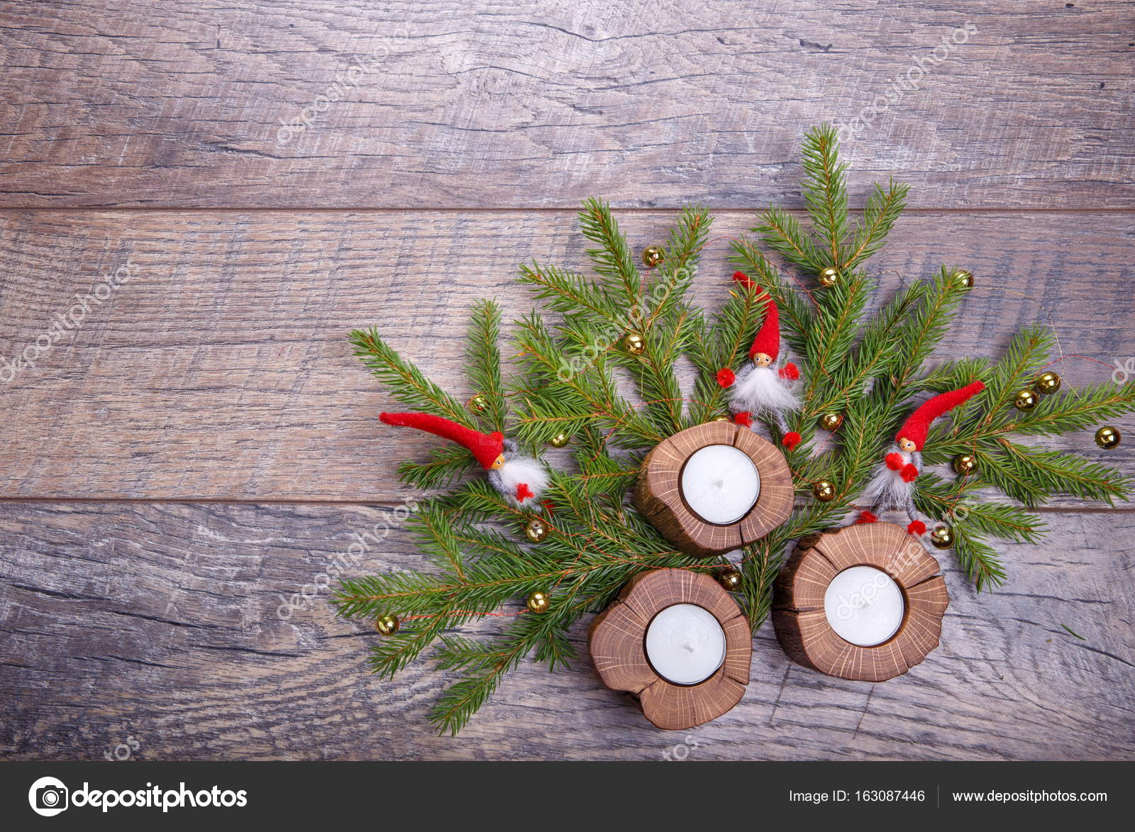 Christmas Gnome Decor.Christmas Wooden Background With Candles And Red Balls