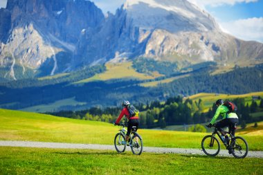 Tourists cycling in Seiser Alm