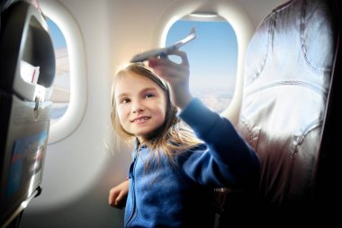 girl traveling by an airplane