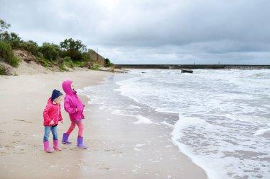 Sisters having fun on Baltic sea