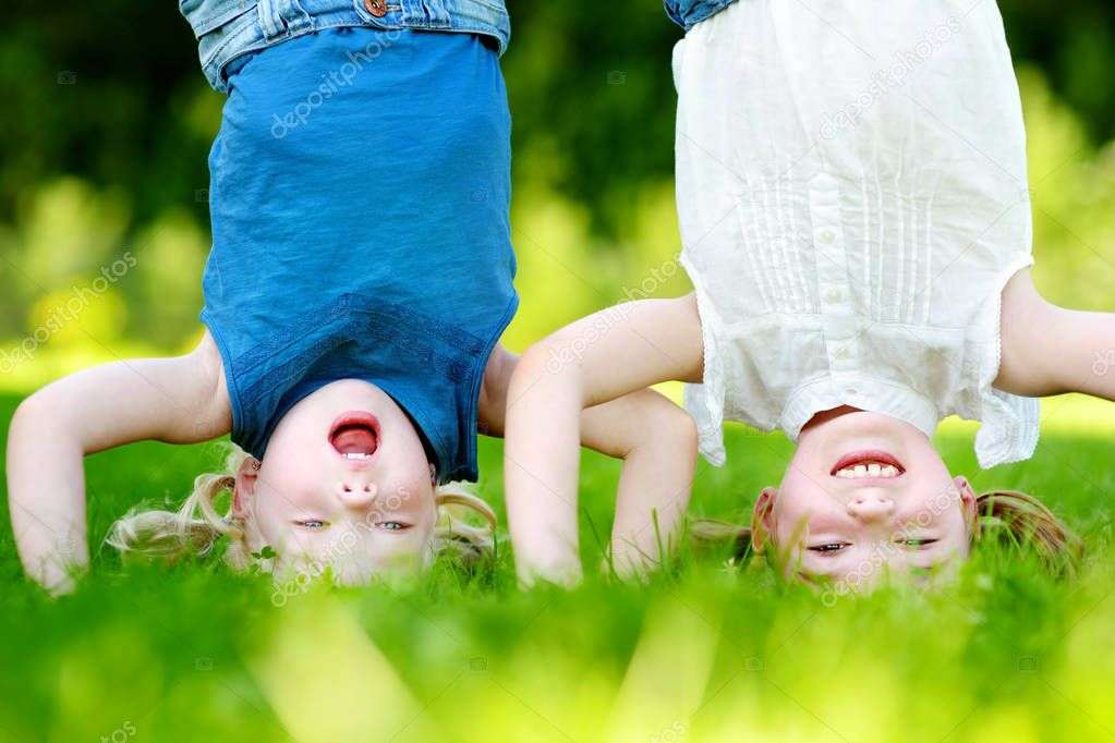 Happy children playing head over heels