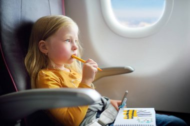 girl traveling by airplane