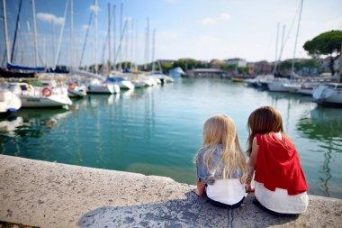 sisters watching small yachts