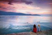 girls enjoying beautiful sunset