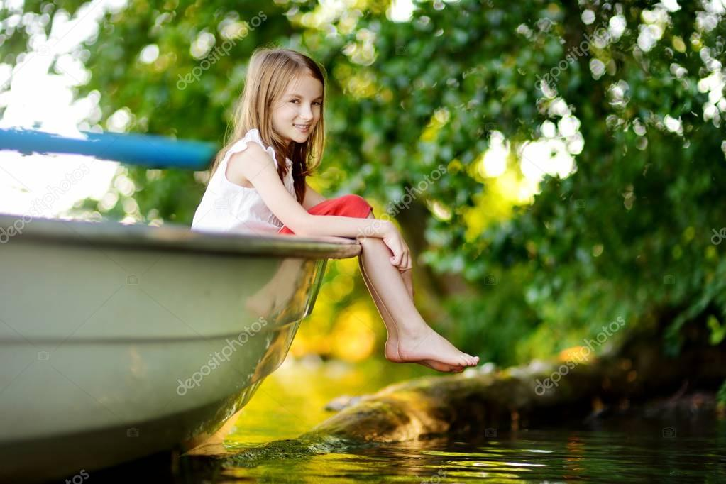 little girl having fun in boat
