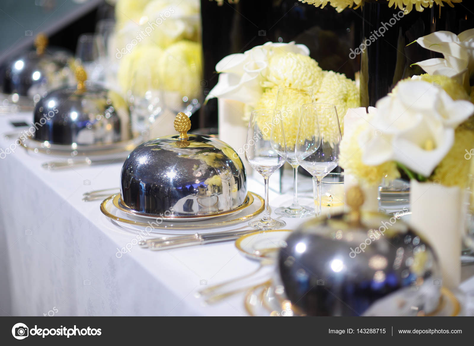 Beautiful table setting with crockery and flowers for a party wedding reception or other festive event. Glassware and cutlery for catered event dinner ... & Beautiful table setting with crockery and flowers u2014 Stock Photo ...