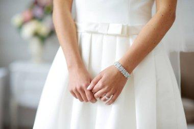 Bride wearing shiny bracelet