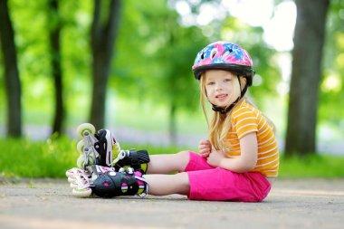 Girl learning to roller skate
