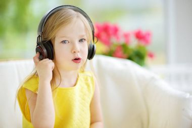 Pretty child listening to kids songs
