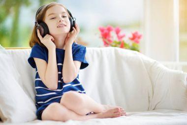 little girl listening to kids songs