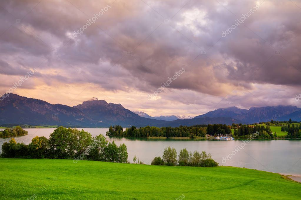 Фотообои Breathtaking landscape of mountains, forest and Bavarian village in  distance. Scenic view of Bavarian Alps with majestic mountains in the background. Bavaria, Germany.