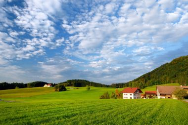 Breathtaking landscape of Austrian countryside field on sunset.