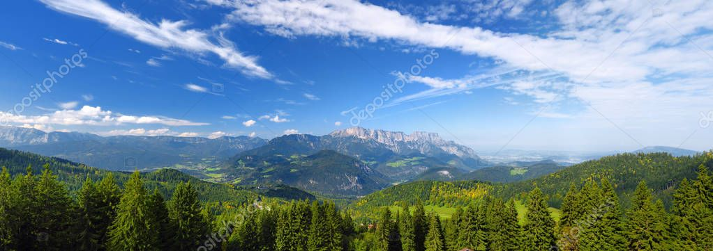Scenic view of mountains, forests and blue sky