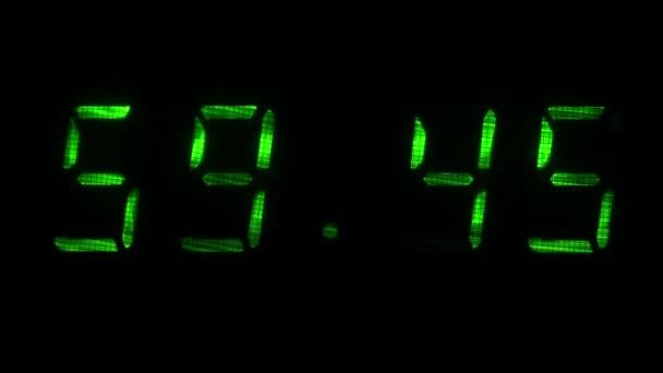 Digitális óra mutatja az időt 59 perc 40 másodperc 00 perc 10 másodperc