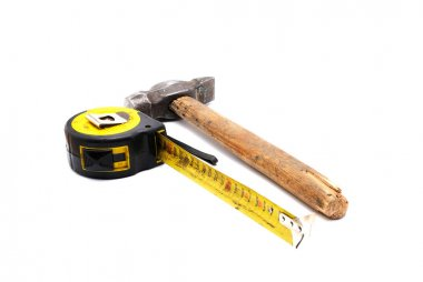 Tools collection - old tape measure and hammer