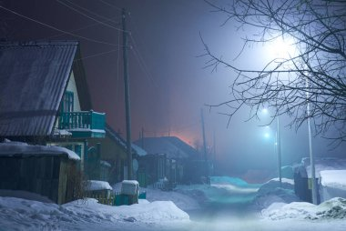 Night shot of country street under snow in winter season