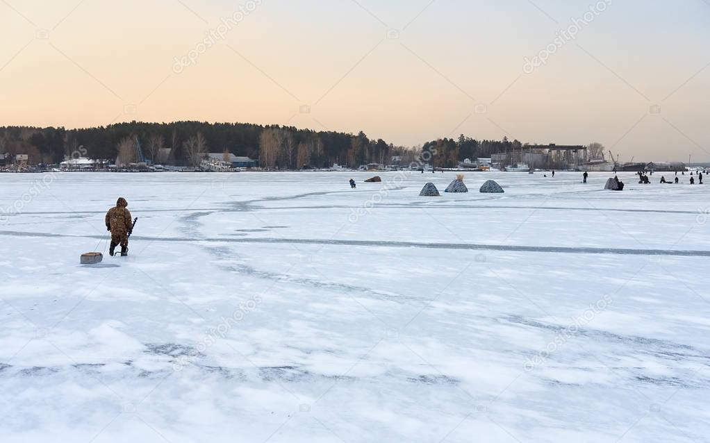 Winter fishing in Siberia - fisher's tents on ice of Ob reservoi
