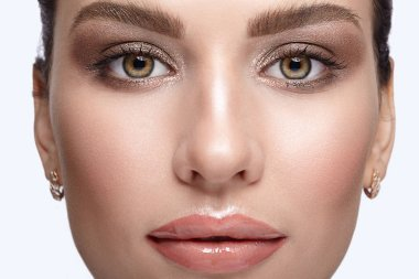 Young female face beauty portrait with day makeup